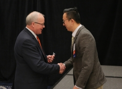 Dr. Zhang (right) accepts the award