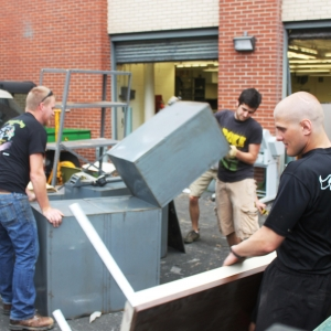 Volunteers clear out the basement of the Whalin building