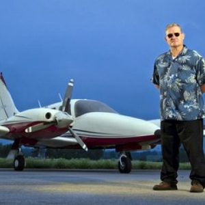 Ralph Gibbs in front of aircraft