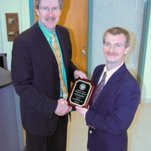 Dennis Field (left) presents award to Geoff Canter